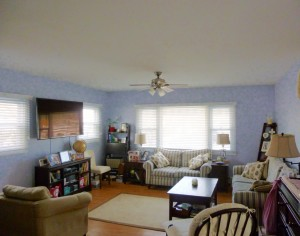 Sunny living room with all new walls, ceilings and floors!